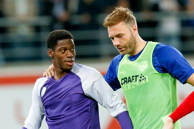 De doelpuntenmakers David en Depoitre praten even bij na de 3-0-zege.