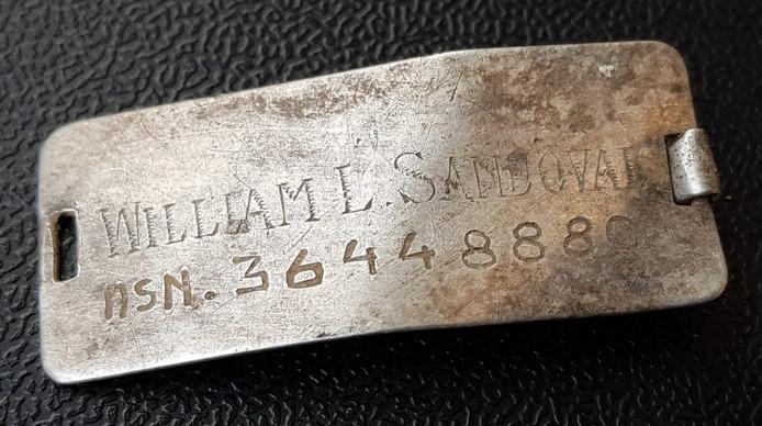 Identiteitsplaatje van William L. Sandoval