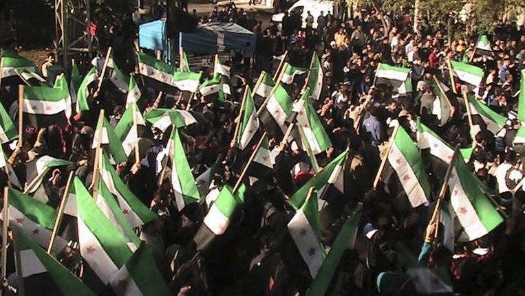 Betogers in Syrië. Beeld reuters