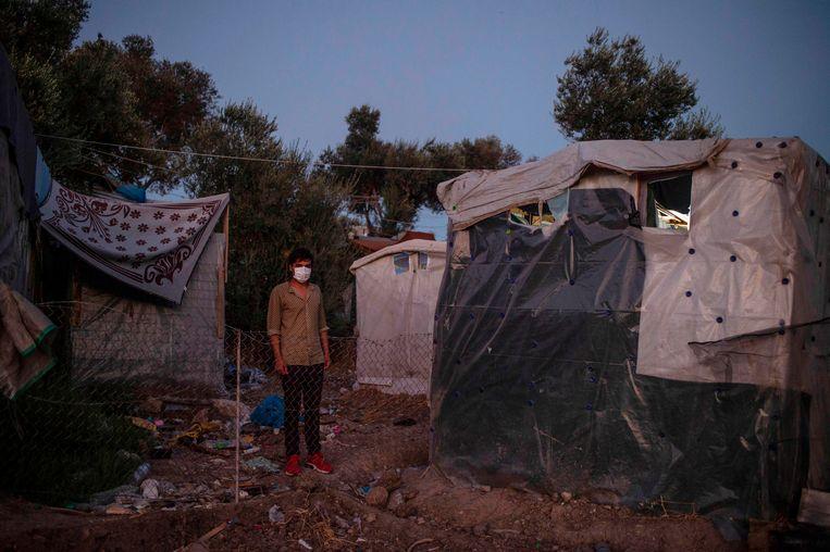 Een migrant op het Griekse eiland Lesbos Beeld AFP