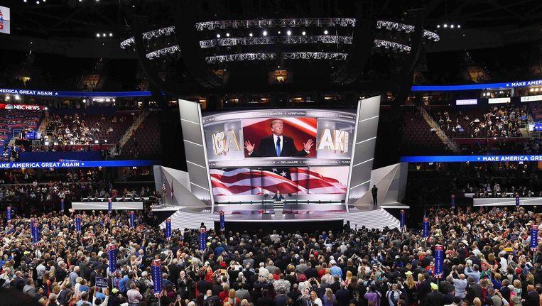 Tegen alle Amerikaanse politieke wetten in verscheen Donald Trump al op de eerste dag van de conventie. Beeld afp