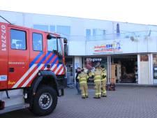 Brand in garagebedrijf Ede, één persoon naar ziekenhuis