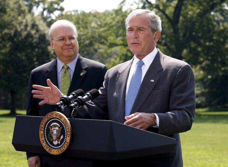 Karl Rove met de voormalige Amerikaanse president George W. Bush. Beeld epa