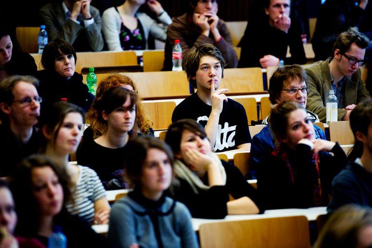 Studenten van de Universiteit van Amsterdam in de collegebanken Beeld ANP