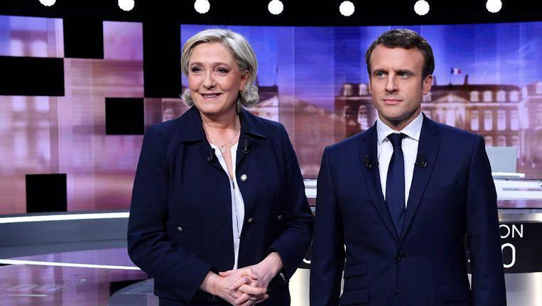 De Franse presidentskandidaten Emmanuel Macron en Marine Le Pen gingen woensdagavond met elkaar in debat. Beeld reuters