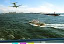Fantasie fotomontage van een vliegveld, Holland Sea Airport, in zee, gezien vanaf een veerboot voor de kust van Nederland.