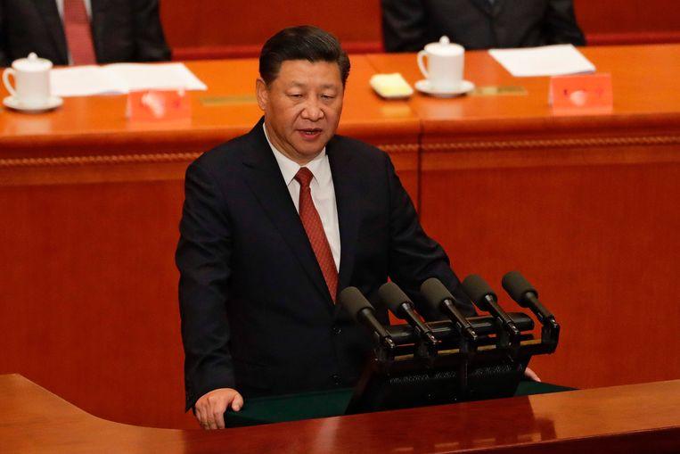 De Chinese president Xi Jinping speecht tijdens de ceremonie van het negentig jarig bestaan van het volksbevreidingsleger. Beeld AFP