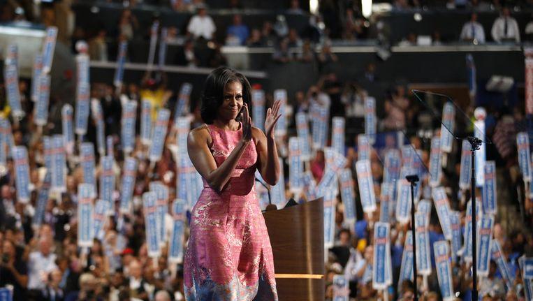 Michelle Obama wordt toegejuicht tijdens de Democratische Conventie. Beeld ap