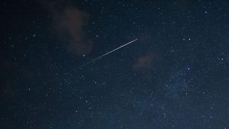 Een vallende ster siert de sterrenhemel boven de Duitse regio Brandenburg. (Archieffoto)