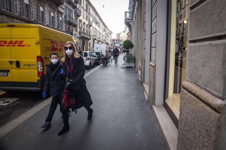 Er zijn maar weinig Italianen op de been in Milaan. De nieuwe noodmaatregel houdt in dat mensen gebieden niet in of uit, behalve in geval van nood. Beeld EPA