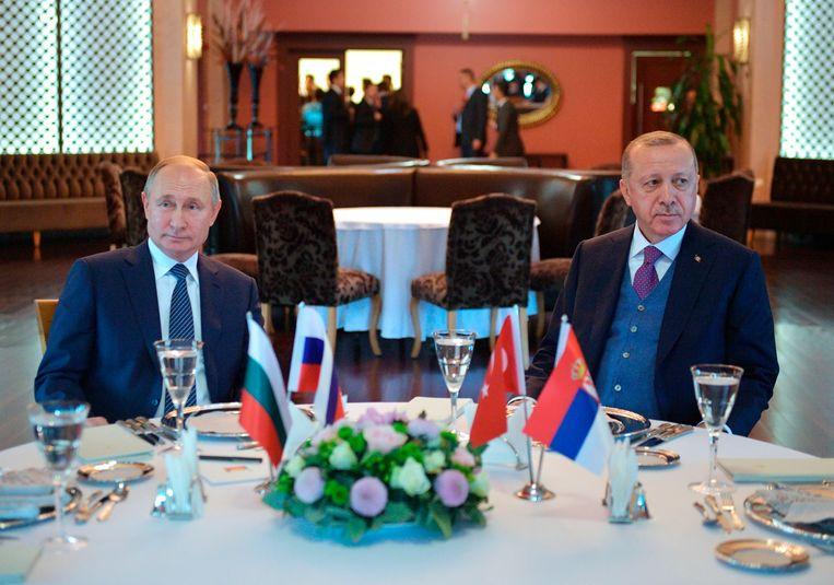 De Russische president Poetin en zijn Turkse collega Erdogan in januari dit jaar. Beeld AP