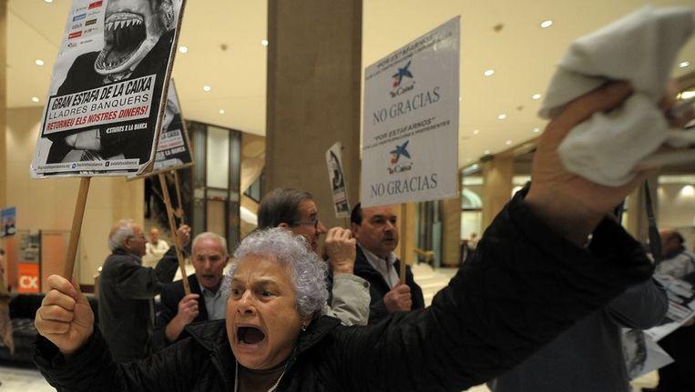 Spanjaarden protesteren tegen wanbeleid bij Spaanse banken Beeld ANP