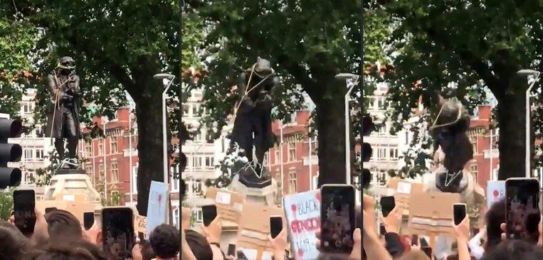 Demonstranten in de stad Bristol trokken zondag het standbeeld van  Edward Colston  (1636-1721) van zijn sokkel en dumpten het beeld in een havendok. (1/3)