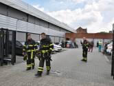 Politiebureau Tilburg ontruimd na flinke hoestbuien van agenten, vijf mensen nagekeken in ambulance