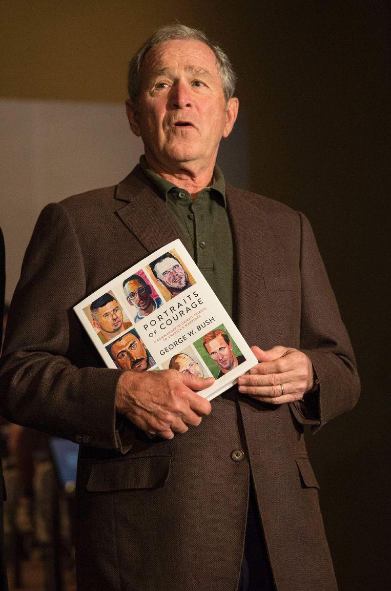 Bush bij presentatie van zijn boek Portraits of Courage Beeld ap