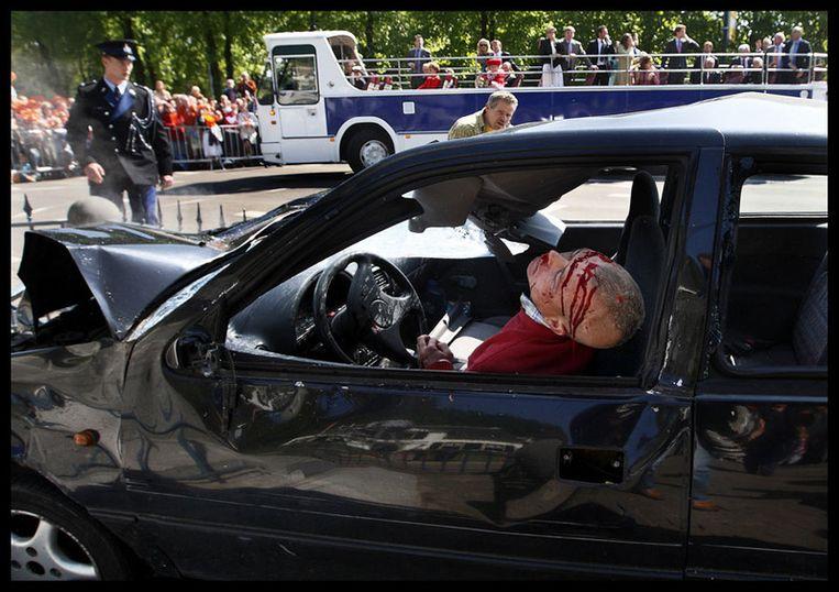 Pim Ras heeft met zijn foto van Karst T., de dader van de aanslag op Koninginnedag, de Zilveren Camera 2009 gewonnen. Foto ANP Beeld