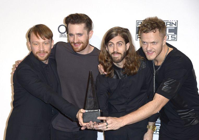 Imagine Dragons na ontvangst van een American Music Award voor Favorite Alternative Artist in 2014. Beeld ANP