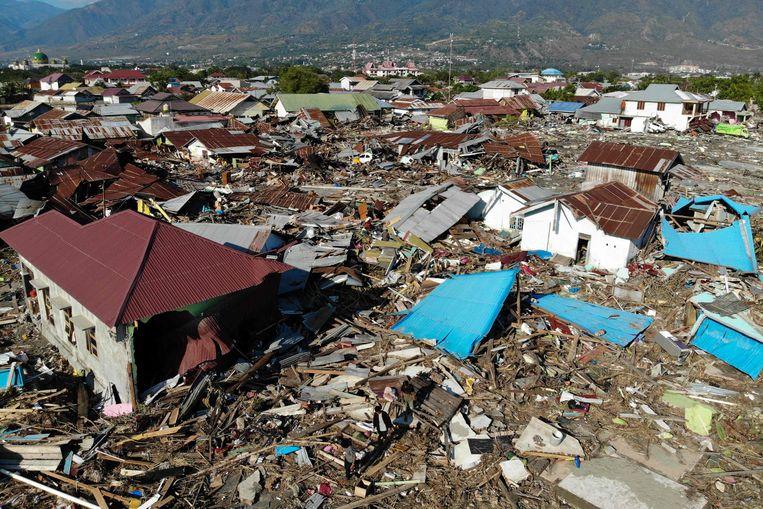 Luchtfoto van een wijk van Palu die compleet is verwoest na de aardbeving en de daaropvolgende tsunami. Beeld AFP