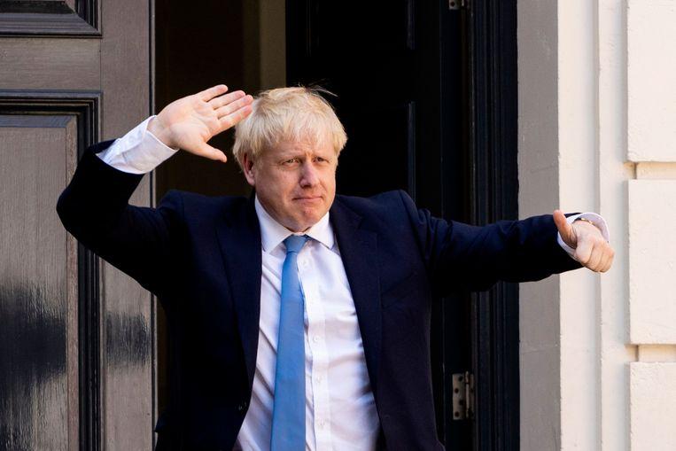 Boris Johnson dinsdag bij het partijbureau van de Conservatieven in Londen.  Beeld AFP
