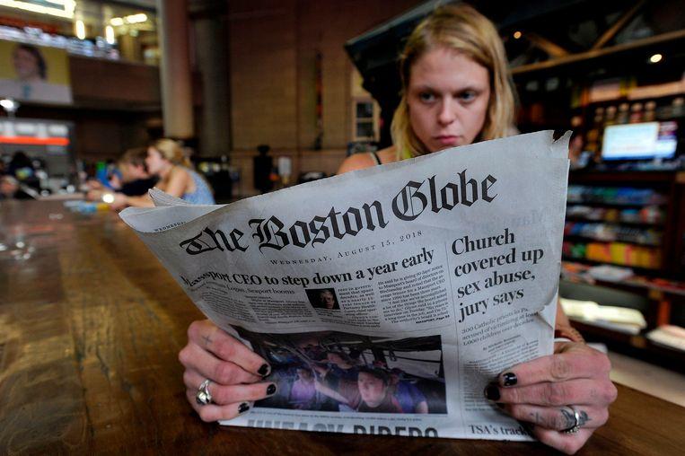 The Boston Globe van 15 augustus. De krant riep nieuwsorganisaties op de aanvallen van president Trump op de media te veroordelen. Beeld AFP
