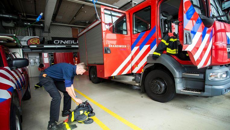 Onder de Amsterdamse brandweerlieden is slechts 2 procent vrouw. Beeld anp