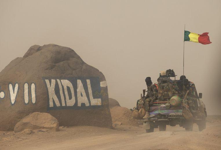 Malinese soldaten arriveren bij de noordelijke stad Kidal. Beeld ap