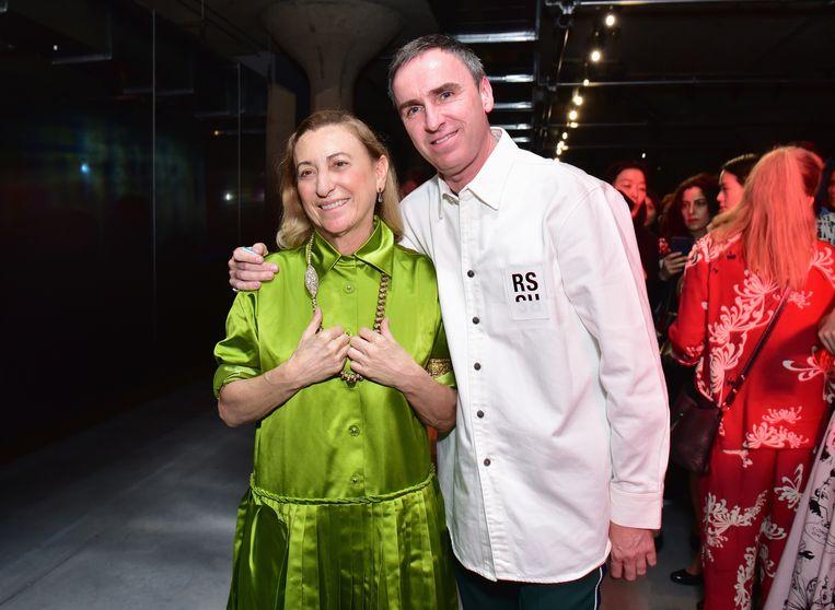 Simons deelt zijn nieuwe job met ontwerpster Miuccia Prada, die het modehuis in 1978 erfde.