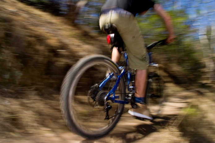 stockadr mountainbike sport A stock photograph of an active young man riging through the country on a mountain bike.