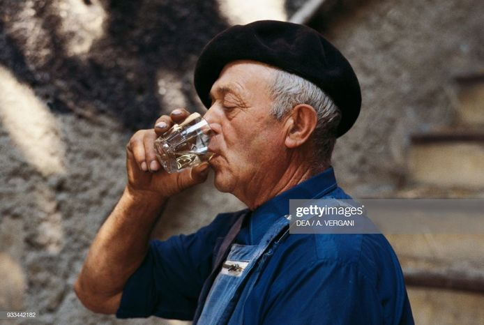 Man wearing a beret tasting a glass of wine, Alsace-Lorraine-Champagne-Ardenne, France.