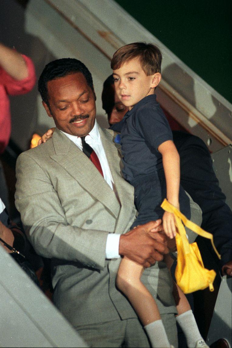 De Amerikaanse burgerrechtenactivist Jesse Jackson met Stuart.  Beeld Reuters