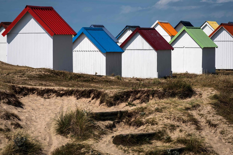 Strandhuisjes in het noorden van Frankrijk. Beeld AFP