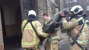 Brandweer haalt bronzen Jezusbeeld van Heilig Hartkerk