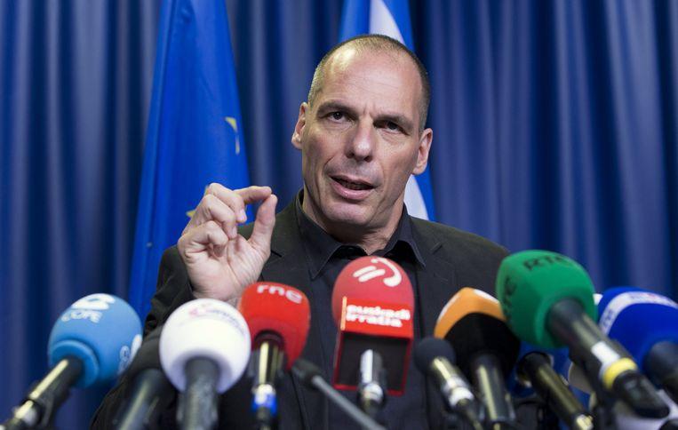 Varoufakis tijdens zijn persconferentie in Brussel. Beeld REUTERS