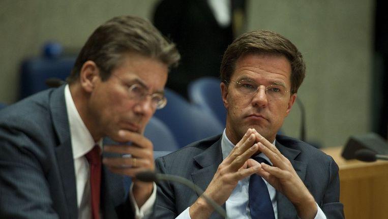 Premier Rutte en minister Verhagen tijdens het debat over de val van het kabinet. Beeld anp