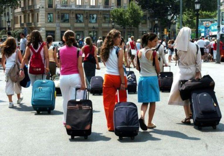 Barcelona. De lokale bevolking heeft het gevoel dat toeristen de stad hebben overgenomen. Beeld
