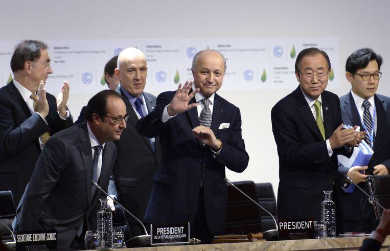 Blije gezichten bij de ondertekening van het klimaatakkoord van Parijs in 2015. Beeld AFP