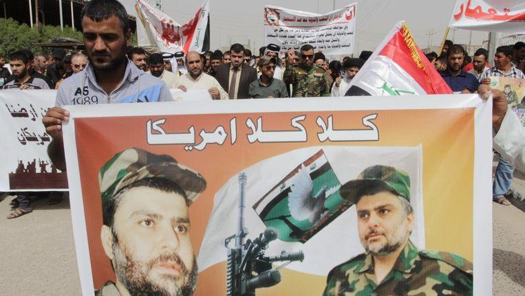 Aanhangers van de sjiitische geestelijke en militieleider Muqtadah al-Sadr. Beeld reuters