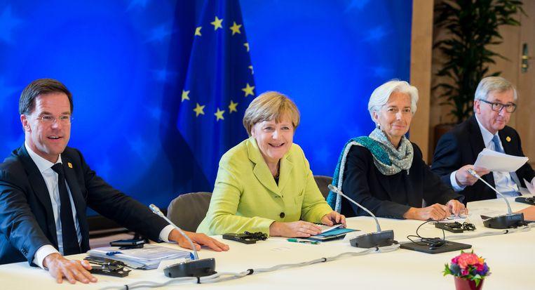 Premier Mark Rutte, Bondskanselier Angela Merkel,toenmalige IMF-directer Christine Lagarde Commissievoorzitter Jean-Claude Juncker op een eurotop in Brussel, anno 2015.  Beeld AP