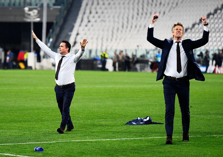 Technisch directeur Mark Overmars en Directeur Edwin van der Sar van Ajax vieren de winst tegen Juventus. Beeld ANP