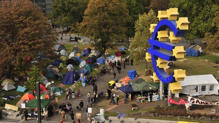 In Frankfurt hebben de betogers van Occupy hun tentjes bij de ECB opgezet. Beeld epa