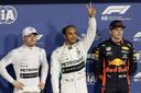 Bottas (tweede tijd maar gridstraf), polesitter Hamilton en Verstappen.