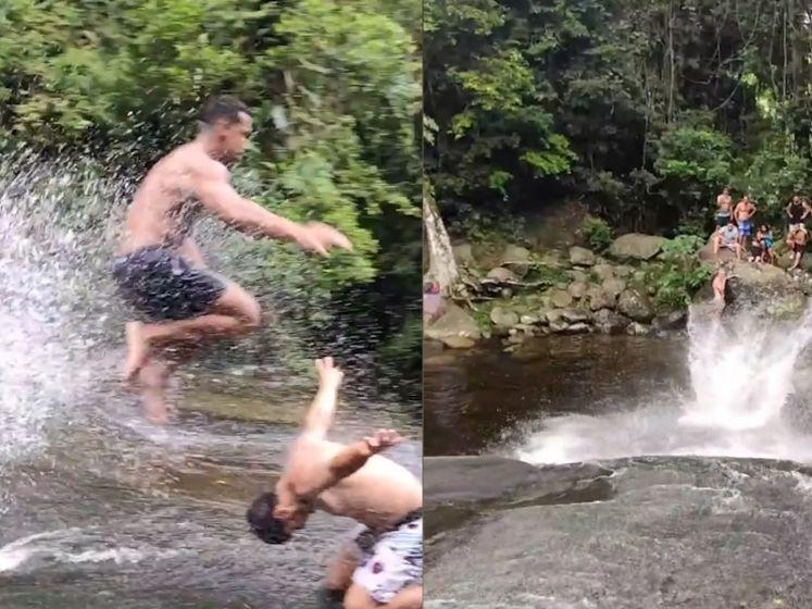 Waaghalzen glijden van natuurlijke waterglijbaan in het midden van het regenwoud