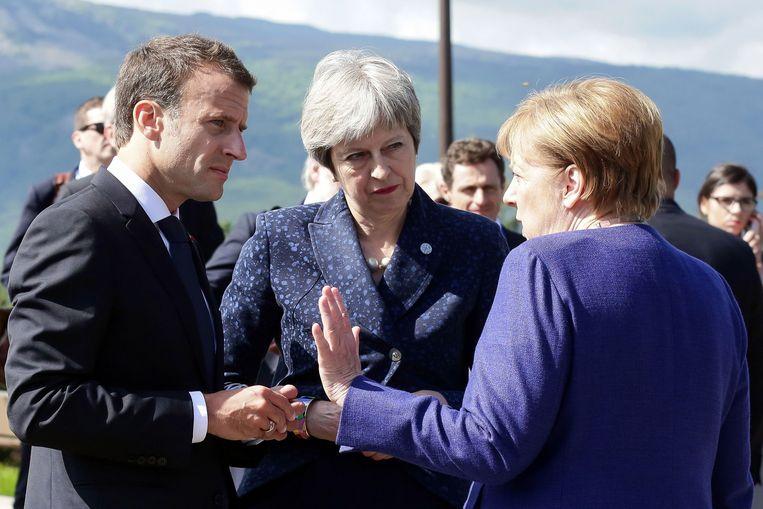 Macron, May en Merkel bij een EU-top in mei. Beeld AFP