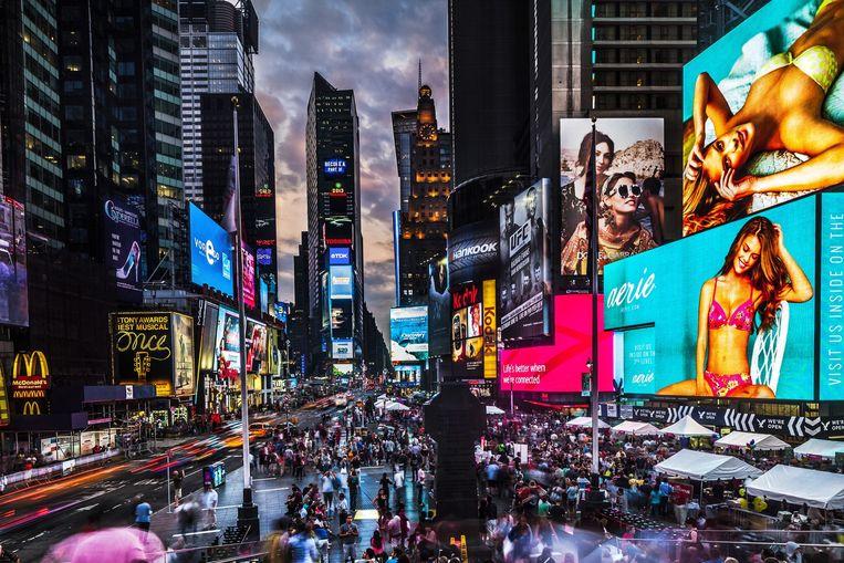 Times Square, New York. 'De eerste keer duizelt het je van alle indrukken, na een half uur word je er niet meer warm of koud van.' Beeld HH