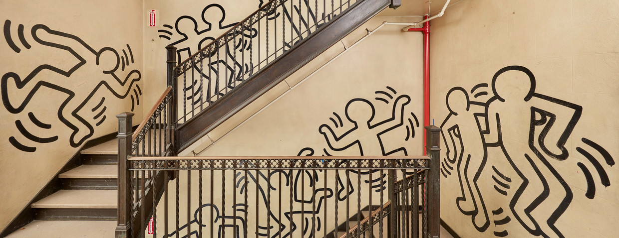 De muurschildering van Keith Haring in Grace House. Beeld Tom Powel