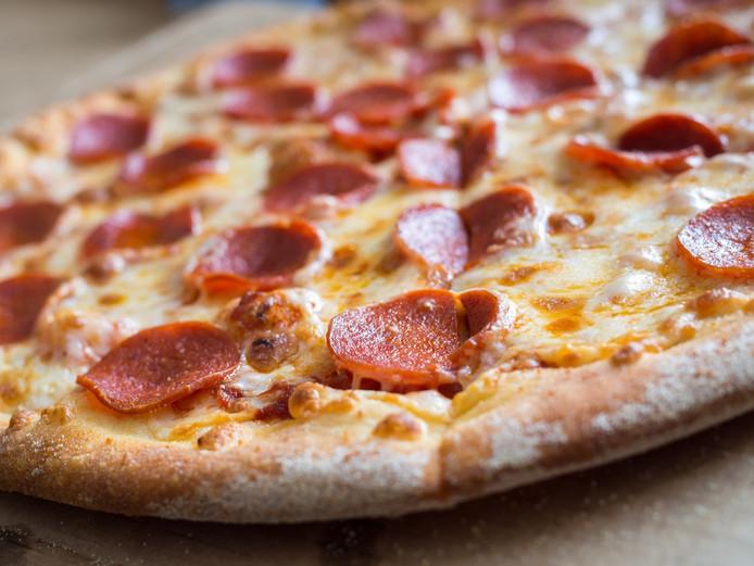 Pizza moet minder zout en vet gaan bevatten