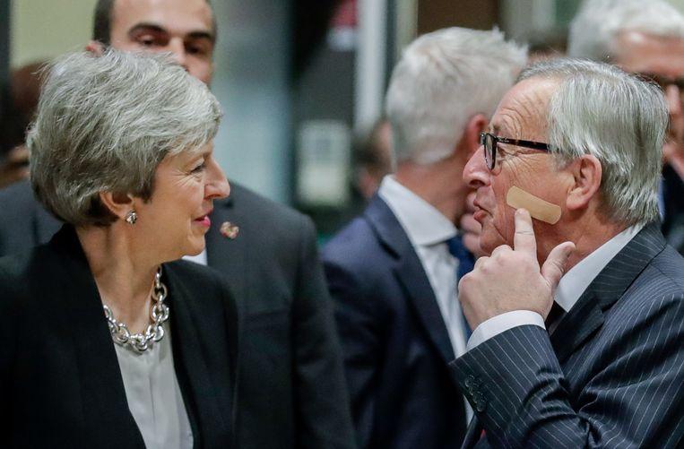 Premier Theresa May en Jean-Claude Juncker, voorzitter van de Europese Commissie.
