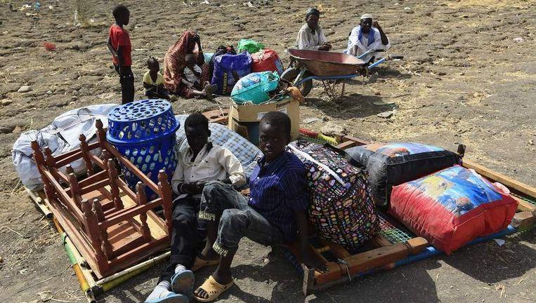 Burgers vluchtten voor een aanval op hun dorp in Zuid-Soedan.