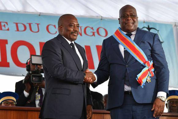 Voormalig Congolees president Joseph Kabila (links) en huidig Congolees president Félix Tshisekedi (rechts) op hun laatste ontmoeting op 25 januari toen het presidentschap werd overgedragen.