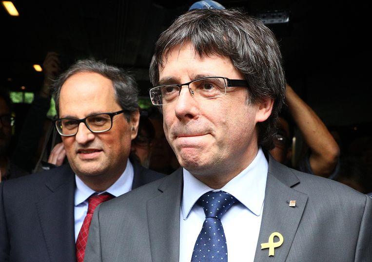 De afgezette Catalaanse minister-president Carles Puigdemont (R) en de nieuwe Catalaanse minister-president Quim Torra (L) in Berlijn vorige maand.